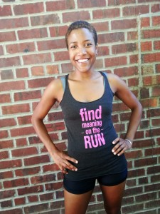 Aliso Desir wearing black tank top that says 'Find Meaning On The Run'