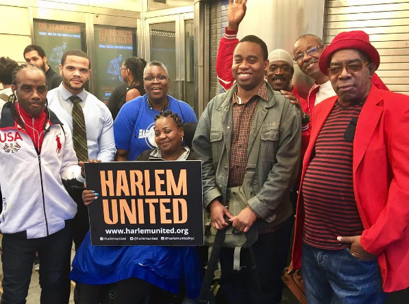 Harlem United clients attend a presidential debate viewing at the Apollo Theater.