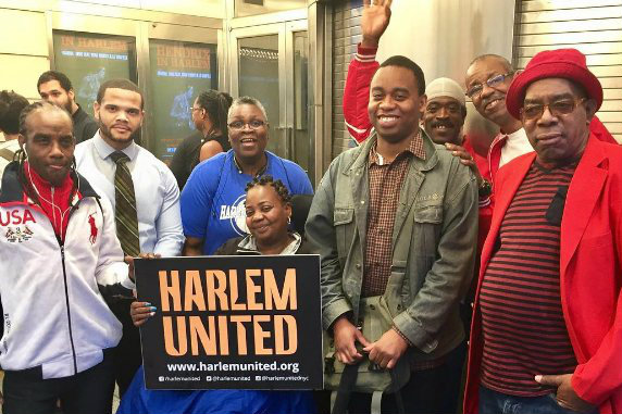Harlem United clients at the Apollo Theater presidential debate viewing party