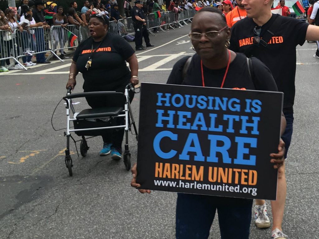 "Harlem United ""Housing is Healthcare"" sign"