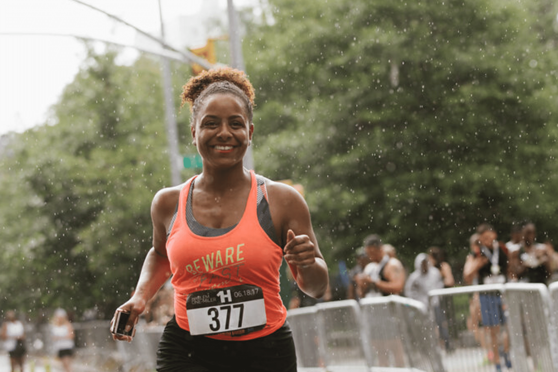 Person runs with a smile on her face
