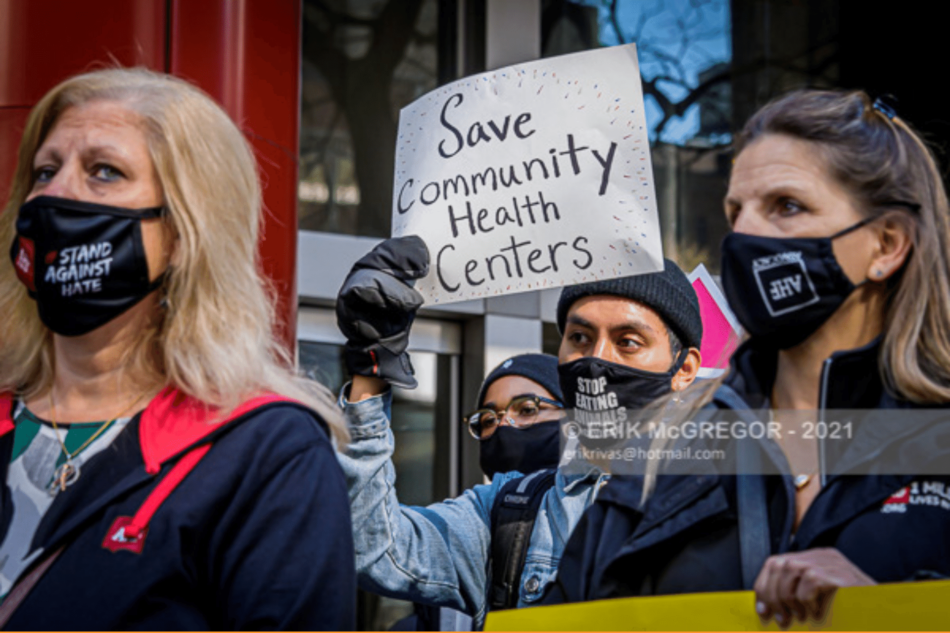 "Activists at a rally. Sign reads ""Save Community Health Centers"""