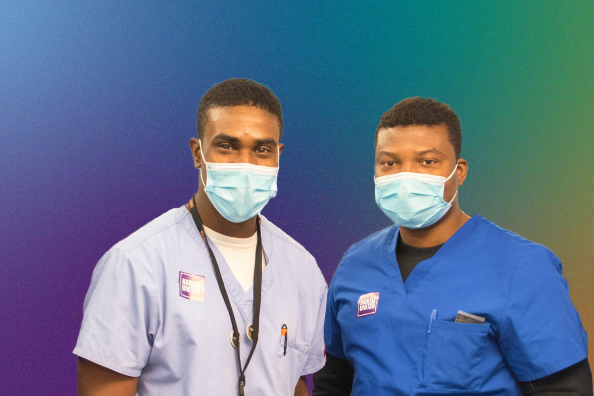 Two healthcare workers wearing masks