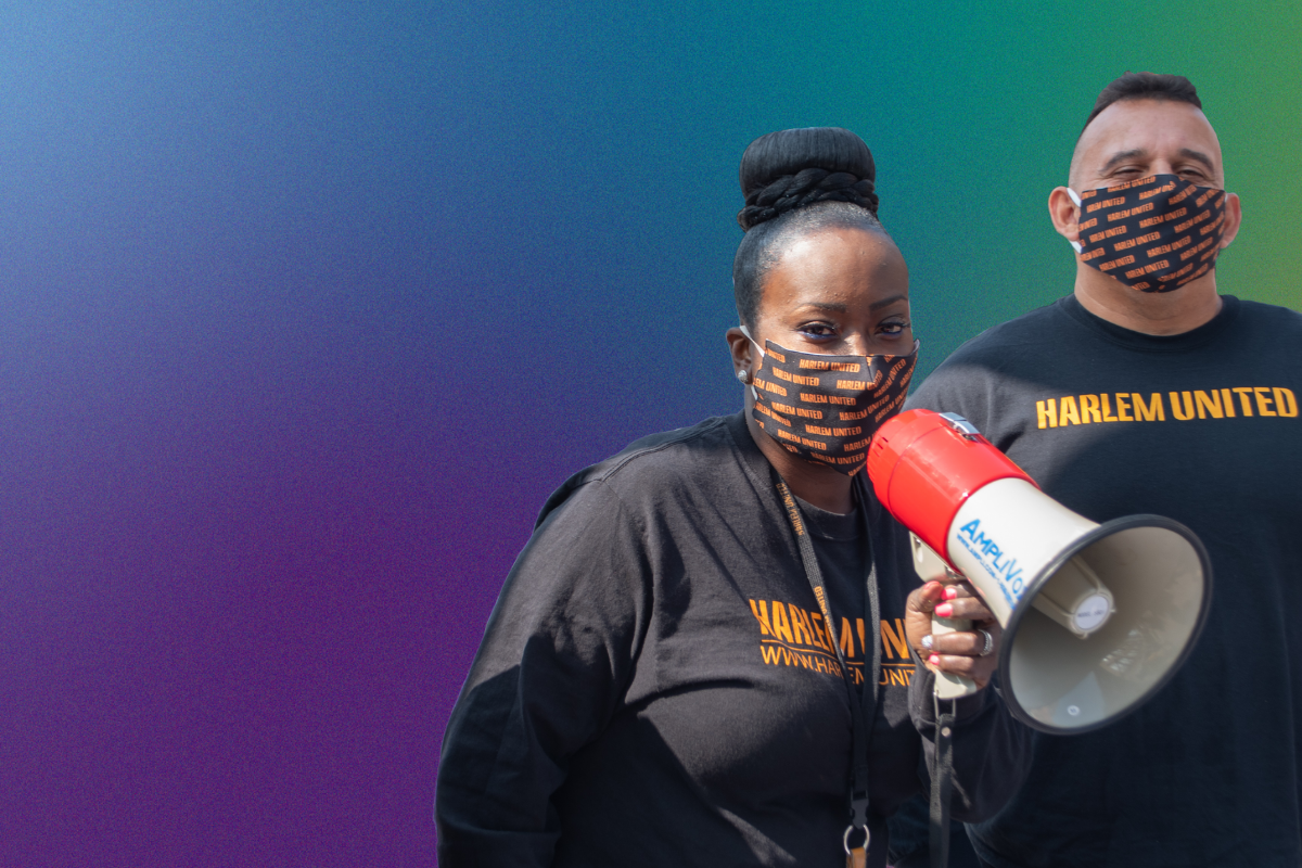 Harlem United staff with megaphone, wearing masks